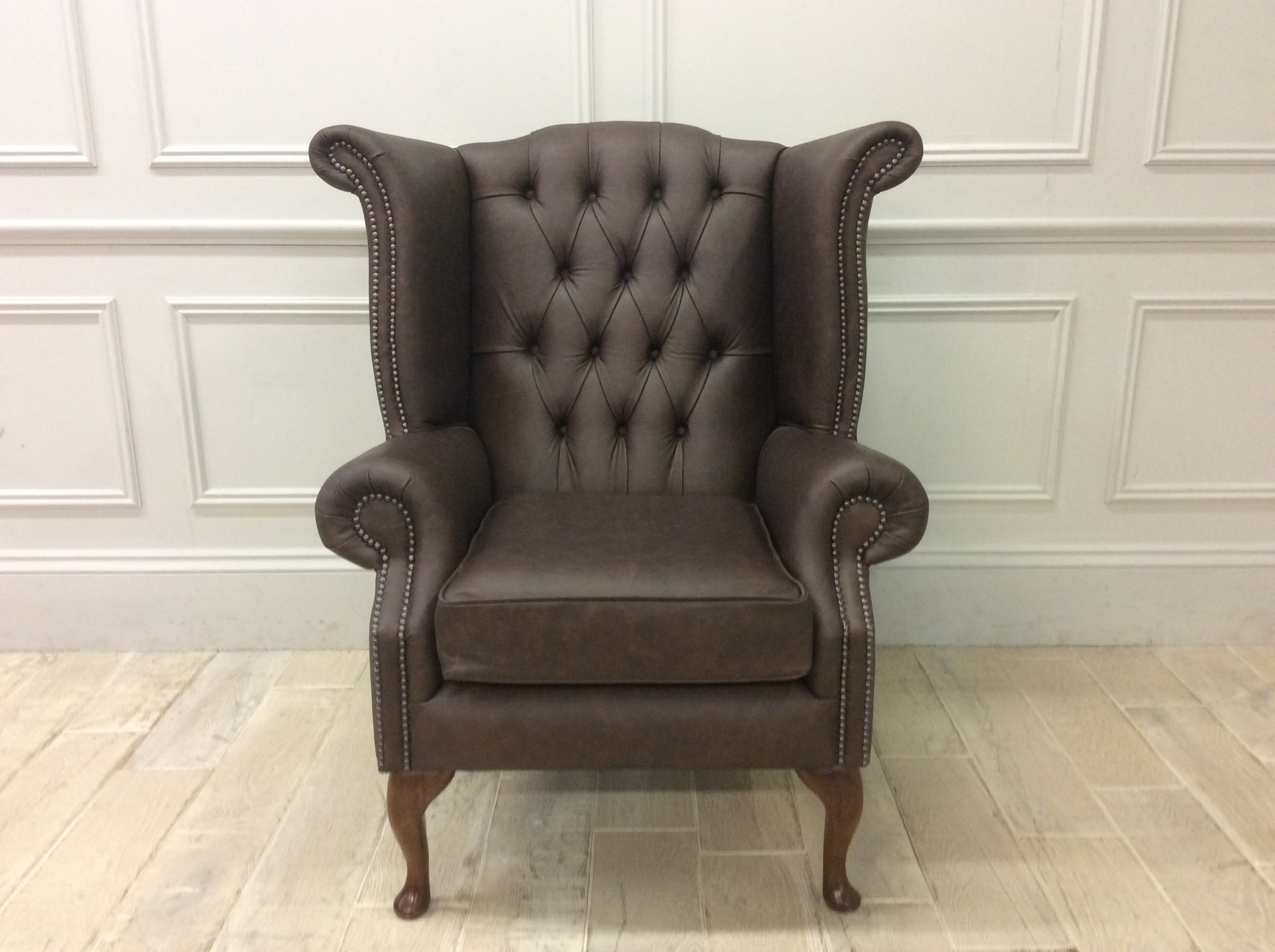 Product photograph showing Queen Anne Scroll Wing Chair Without Castors In Apache Roast Distressed Leather