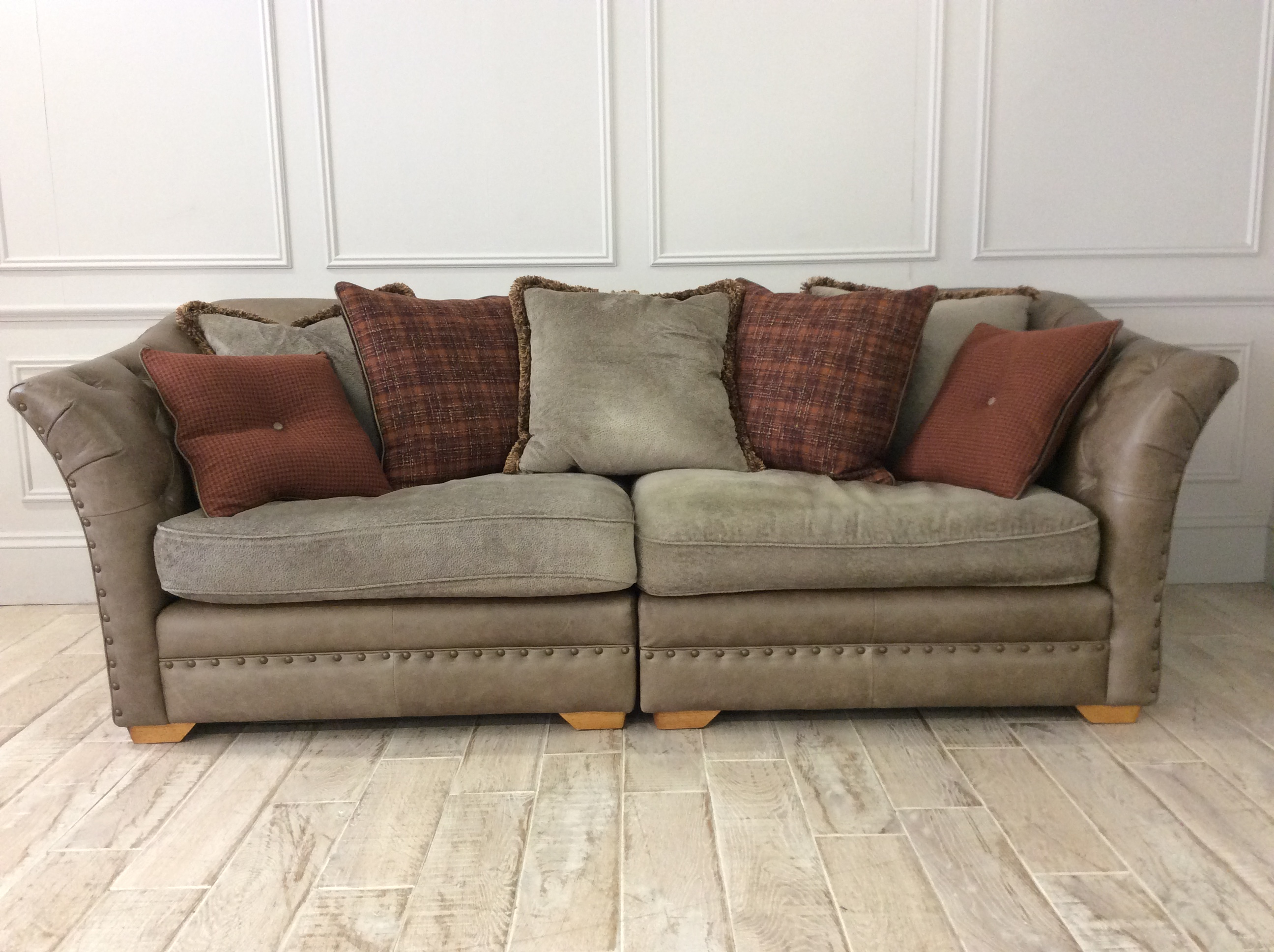 Product photograph showing Chaldon Grand Split Leather And Fabric Mix Pillow Back Sofa