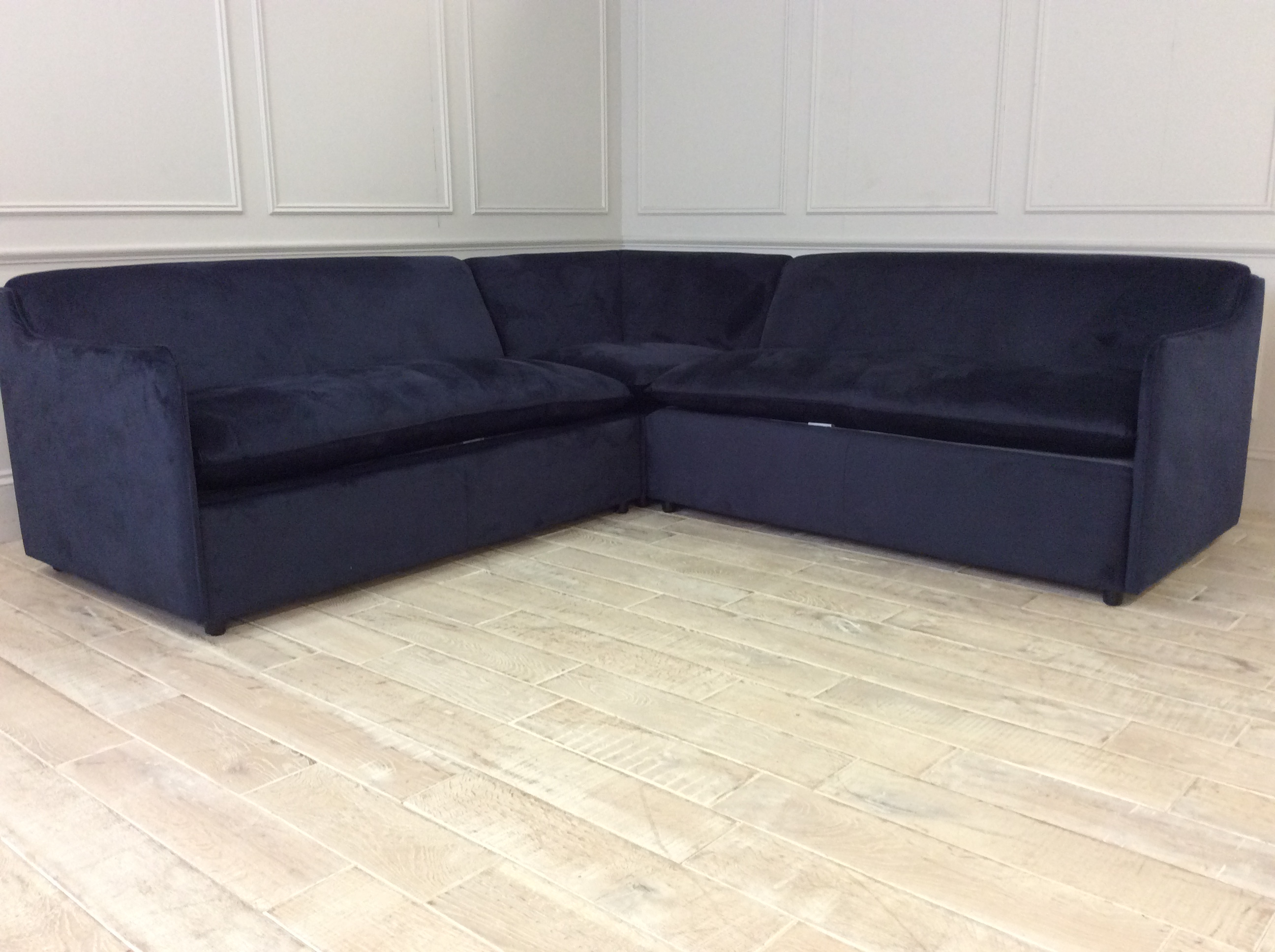 Product photograph showing Norbury 3 X 3 Seater Corner Sofa Bed In Stain Resistant Moleskin Velvet - Navy