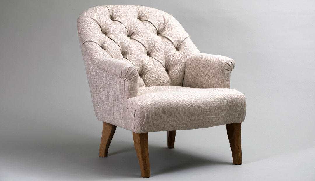Preston Chair shown in Icon Natural with american walnut legs