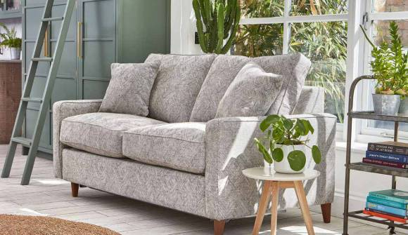 The Beckenham 3 Seater Sofa Bed in Stain Resistant Textured linen Graphite with medium oak feet