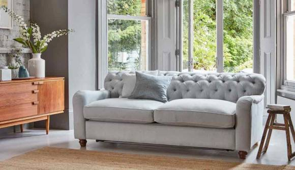 The Bakewell 3 Seater Sofa Bed in Easy Clean Soft As Cotton Cambridge Blue with medium oak feet