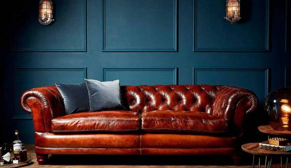 the cairness midi sofa in hard wearing heritage leather chestnut with dark oak feet