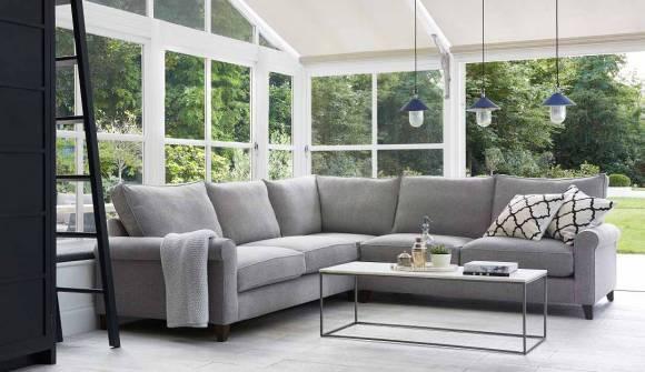 the Dalby Medium Corner Sofa in Linen Cotton Feather Grey with dark oak feet