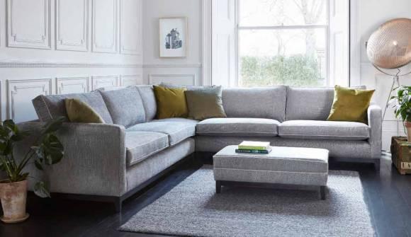 the darwin corner sofa in stain resistant broad weave linen armadillo with dark oak feet