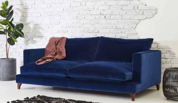 the holland large sofa in stain resistant cotton velvet indigo with dark oak feet