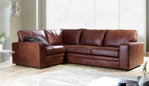 the Sloane corner sofa in Waxy Semi Aniline Tan wit medium oak feet