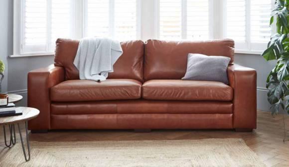 the Sloane 3.5 Seater sofa in Waxy Semi Aniline Tan with medium oak feet