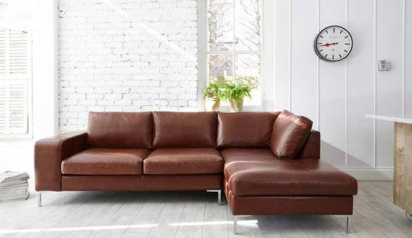 the Kingly chaise sofa in Waxy Semi Aniline Conker with Chrome feet