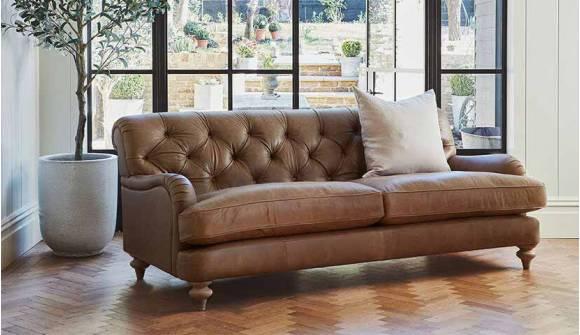 The Woodbridge large sofa in Rustic Hennessey Leather Alpaca with Light Oak Feet