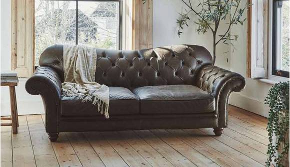 the Woodford 3 Seater sofa  in Distressed Vintage Aniline Truffle with dark oak feet