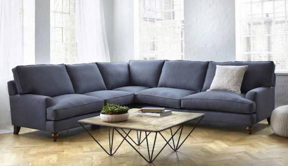 the whinfell corner sofa in linen cotton whale blue with medium oak feet