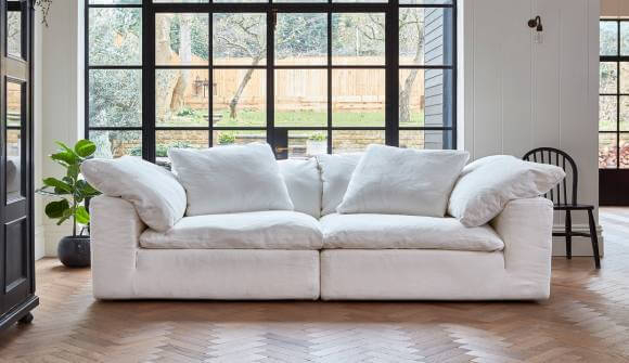 Product photograph showing Feather Extra Deep Fabric 3 Seater Sofa In White Linen
