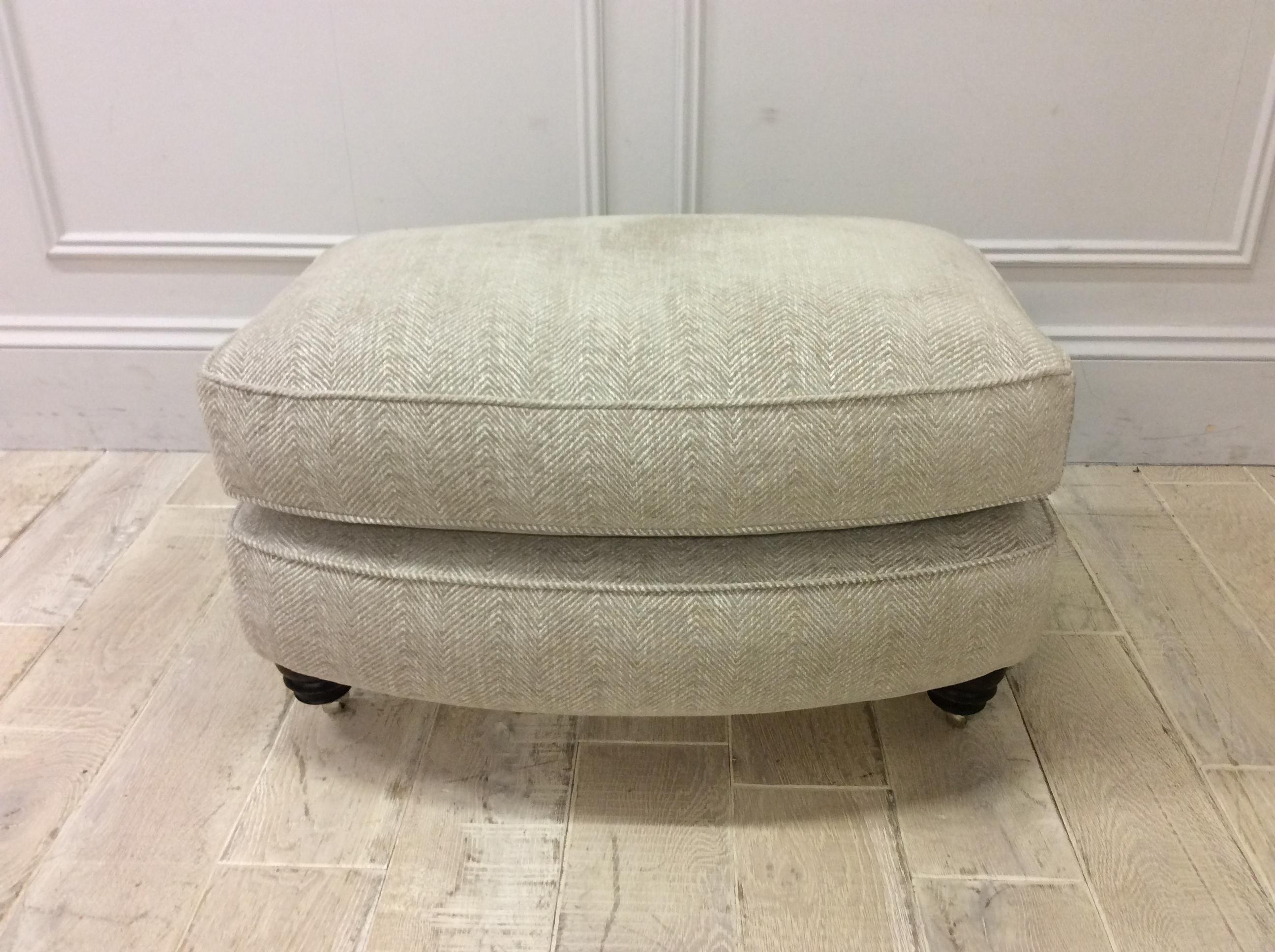 Product photograph showing Duresta Lansdowne Footstool In Premium Bergman Swedish Grey Fabric With Castors