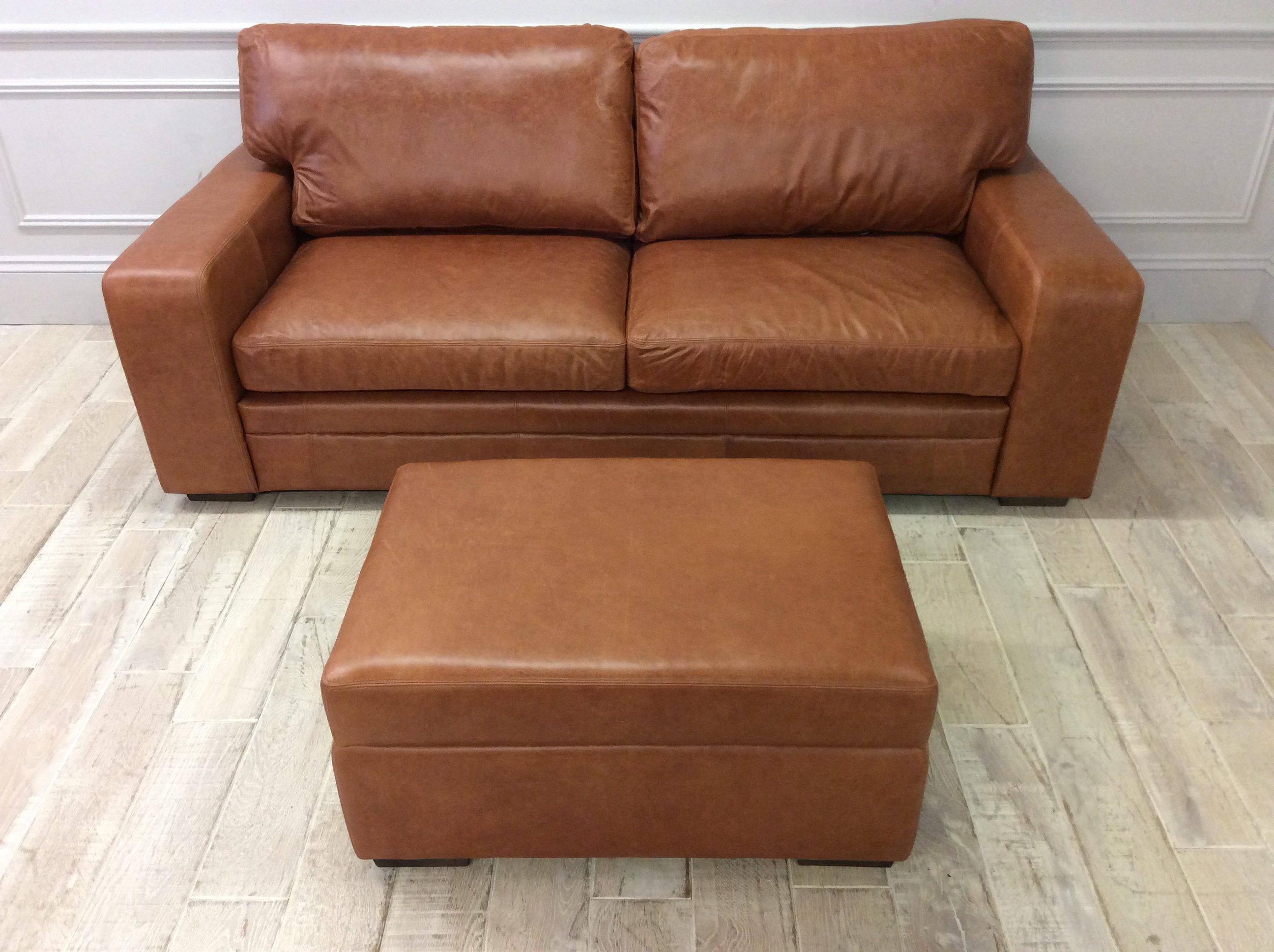 Product photograph showing Sloane 3 5 Seater Sofa With Matching Ottoman In Old English Tan Leather