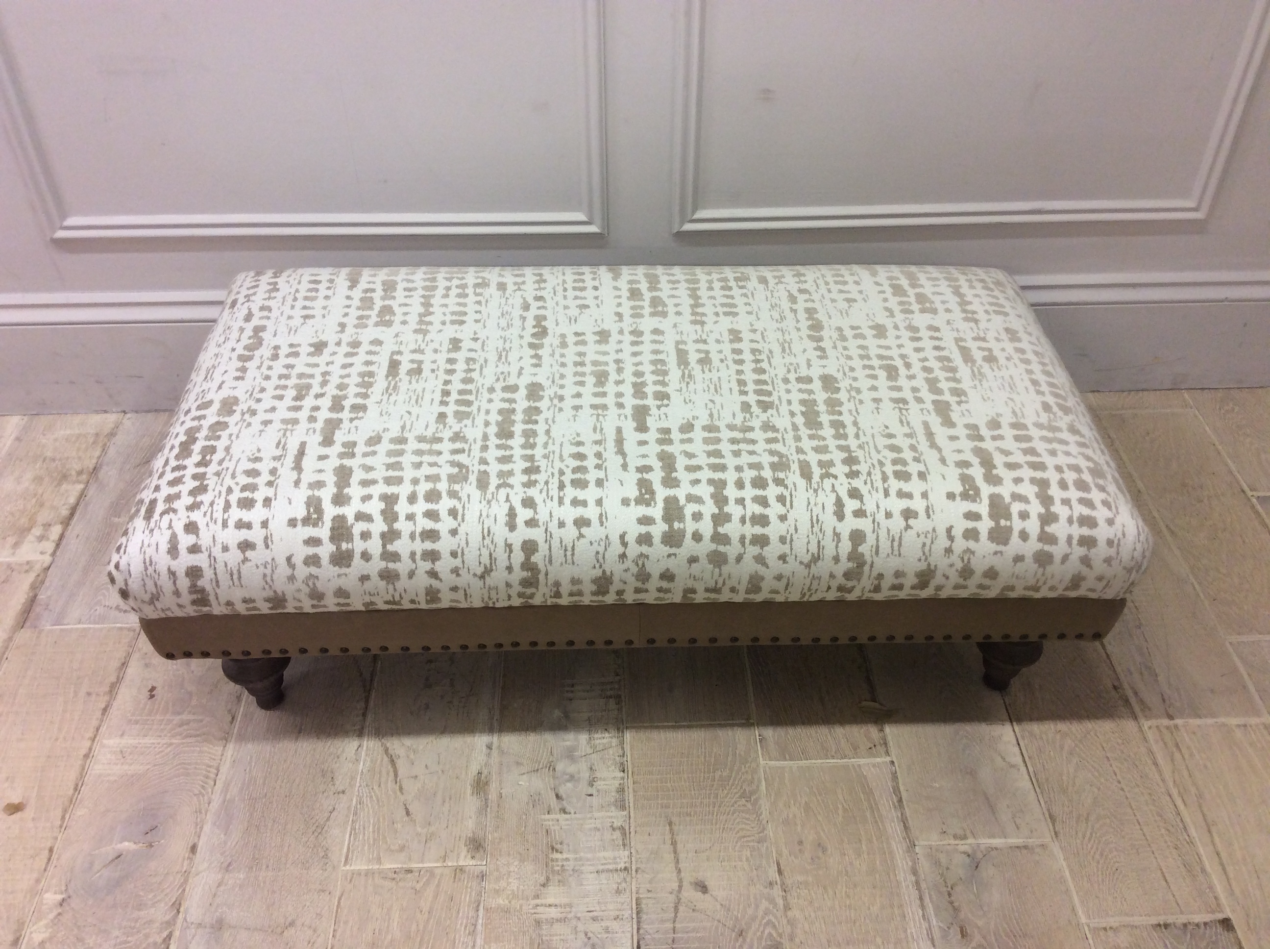 Product photograph showing Dorset Footstool In Arbon Putty Fabric Cotswold Leather