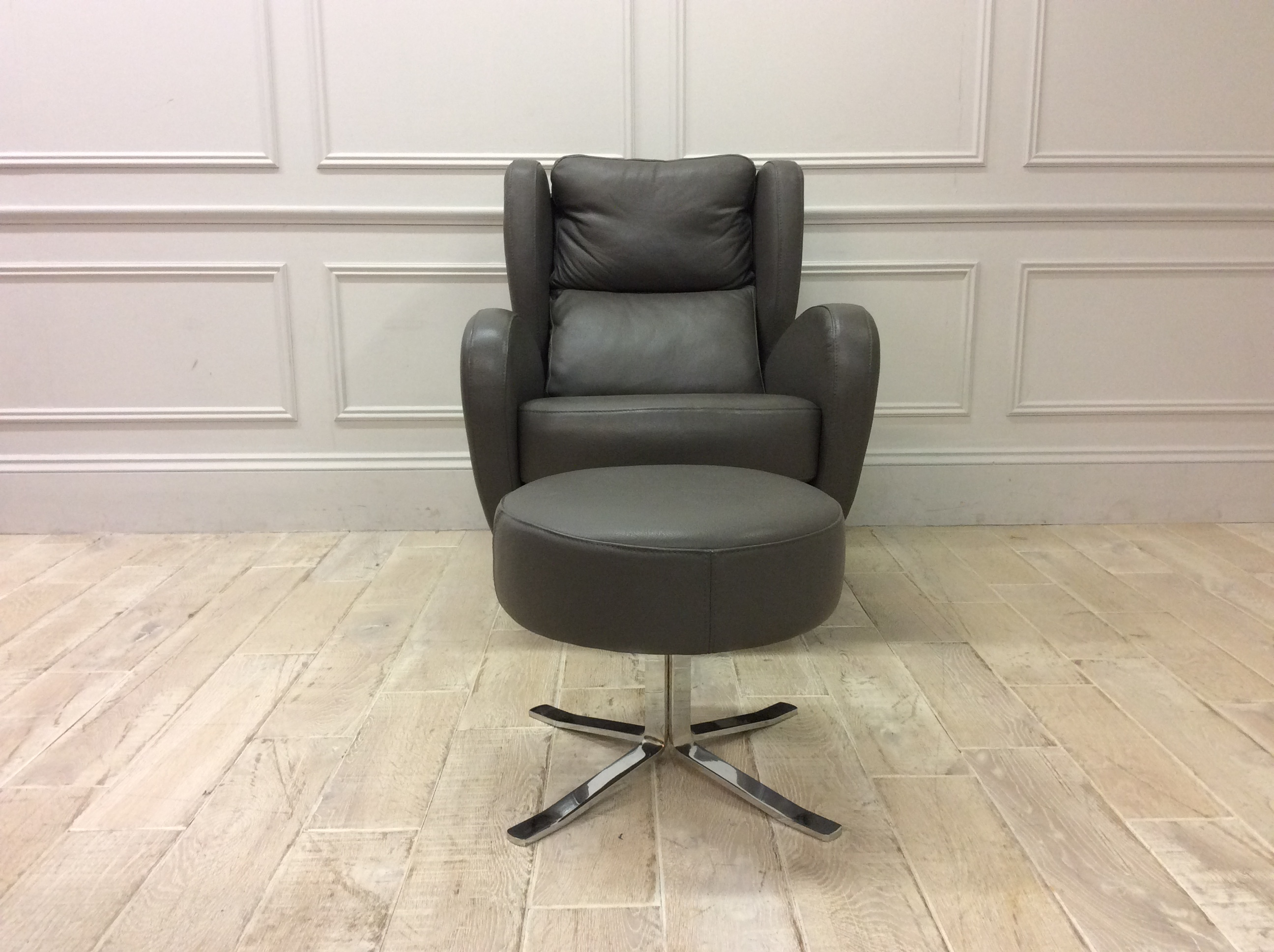 Product photograph showing Raphael Swivel Chair And Footstool In Dalmata 92 Leather
