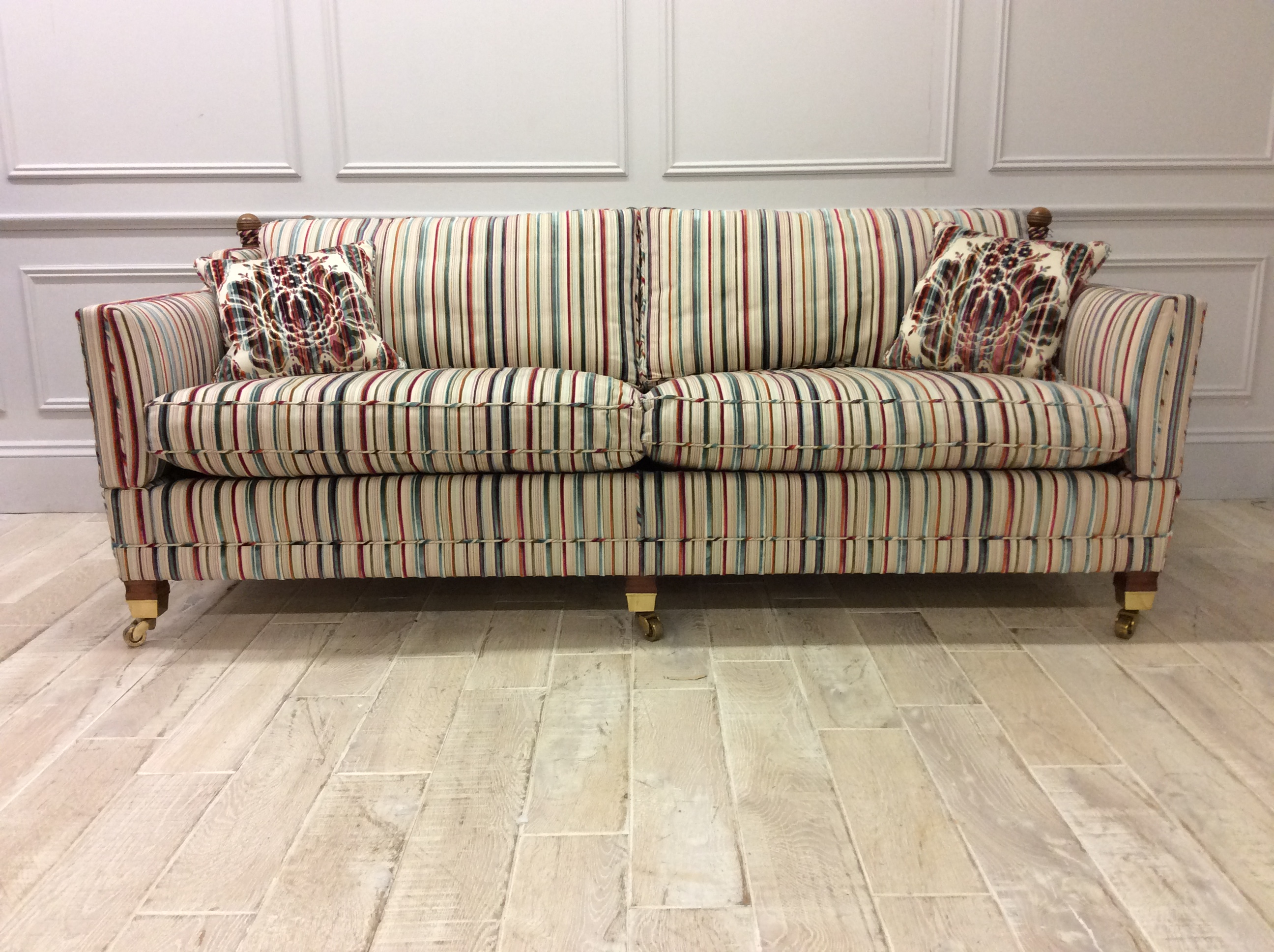 Product photograph showing Duresta Trafalgar 3 Seater Cushion Back Sofa In Bancroft Stripe Gemstone Fabric With Castors