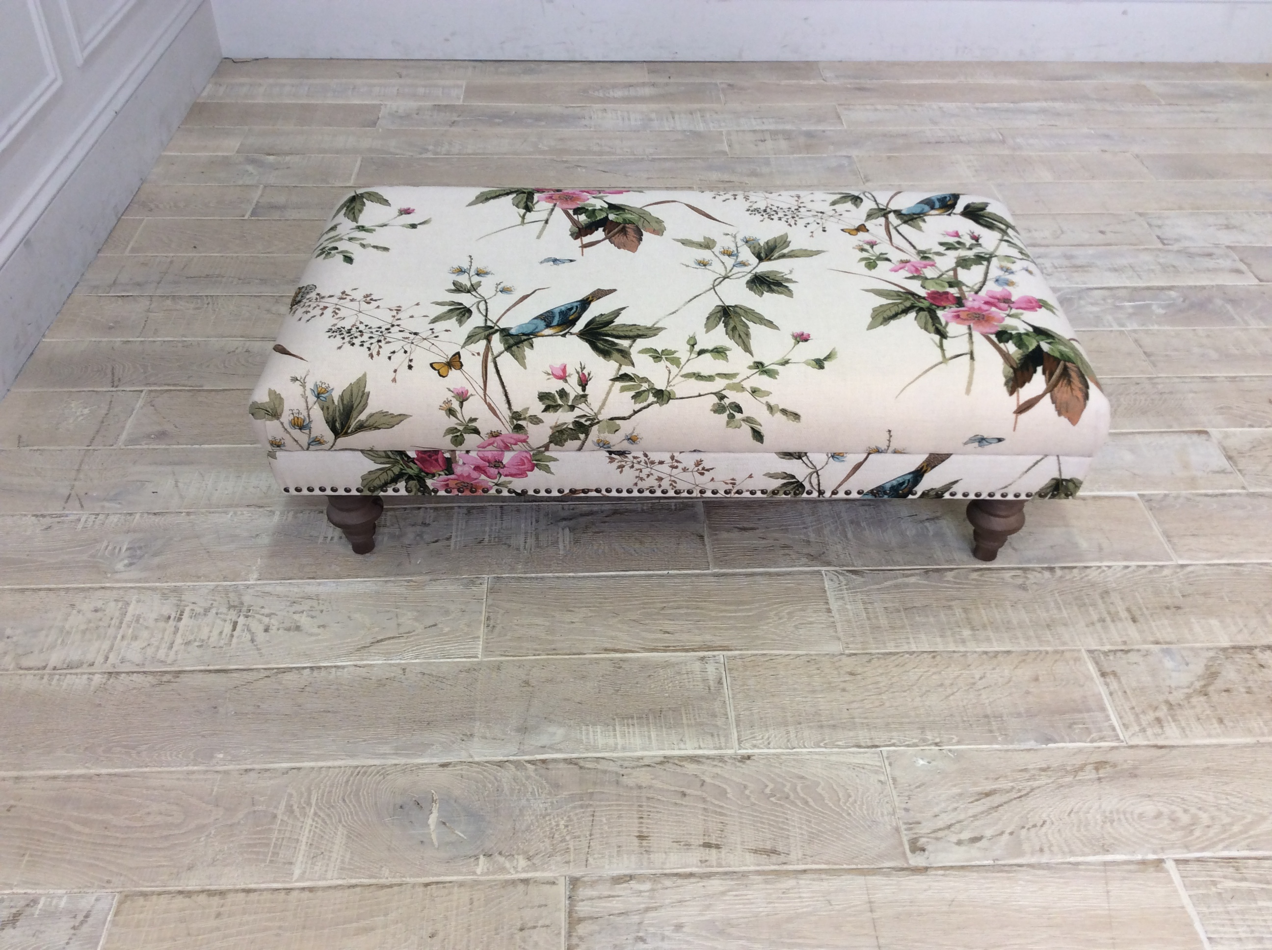 Product photograph showing Wiltshire Fabric Footstool In Stanton Willow Floral Linen