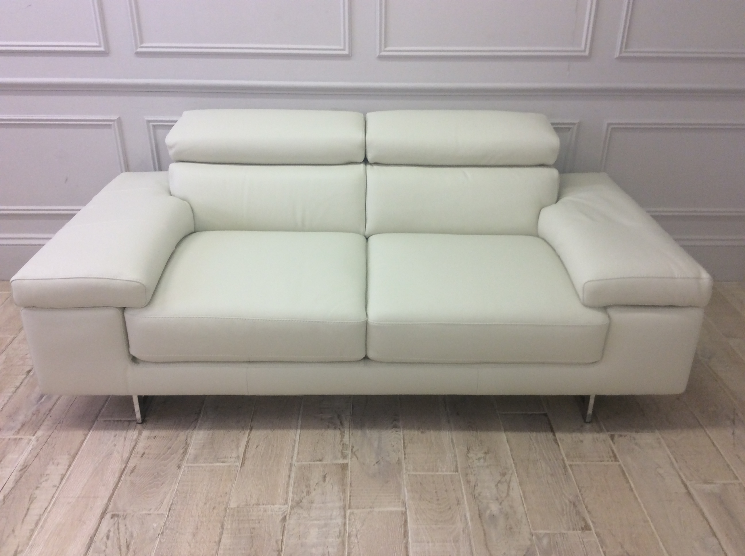 Product photograph showing Milano Medium Leather Sofa With Adjustable Headrests In Italian 10bl Leather And Chrome Legs