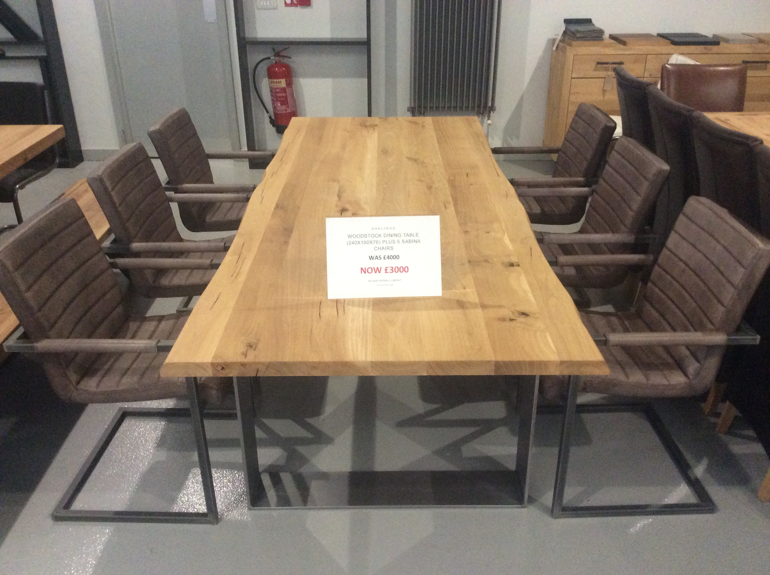 Product photograph showing Woodstock Dining Table 240cm Plus 6 Sabina Leather And Metal Chairs
