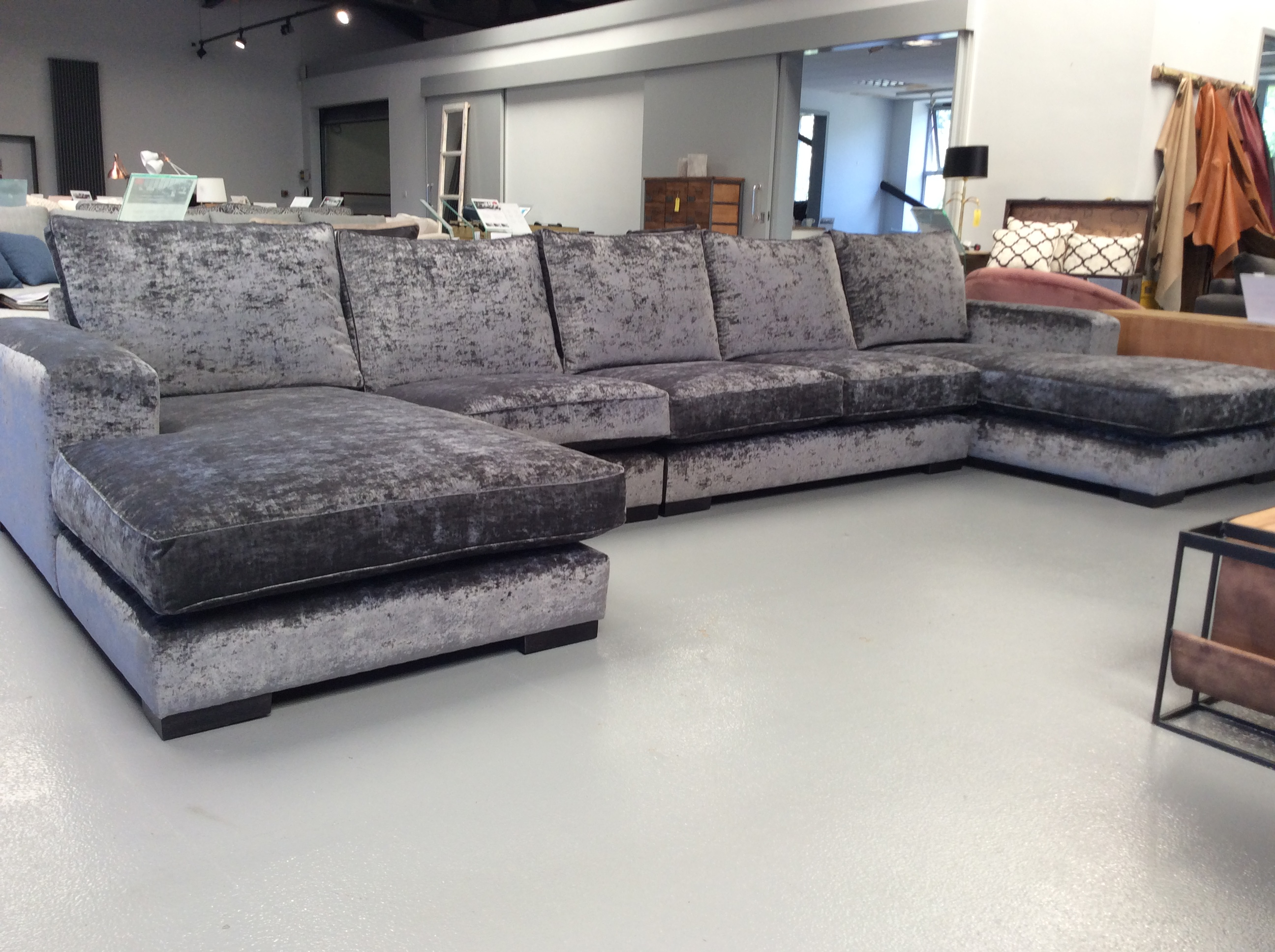 Product photograph showing Ashdown Large U Shape Lounger Sofa In Oneda Anthracite Velvet