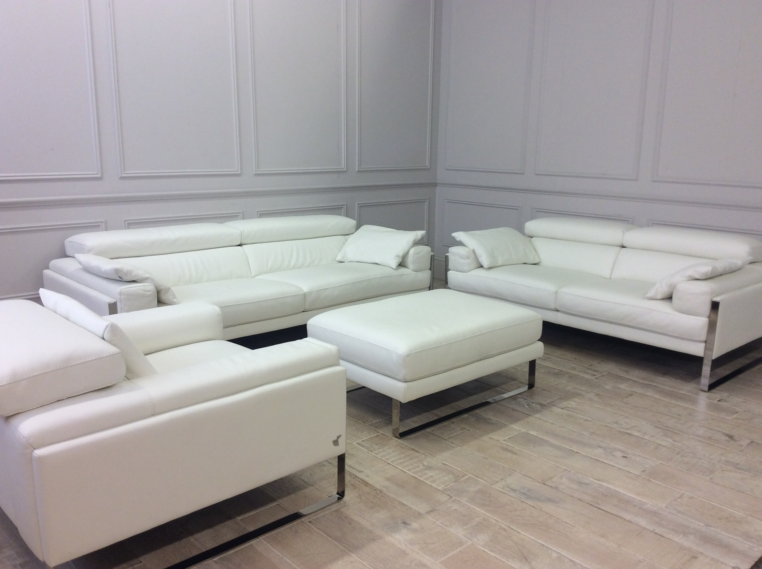 Product photograph showing Rocco Chair 2 Str Sofa 3 Str Sofa Footstool And Scatter Cushions In Bull 370 Bianco Puro Leather