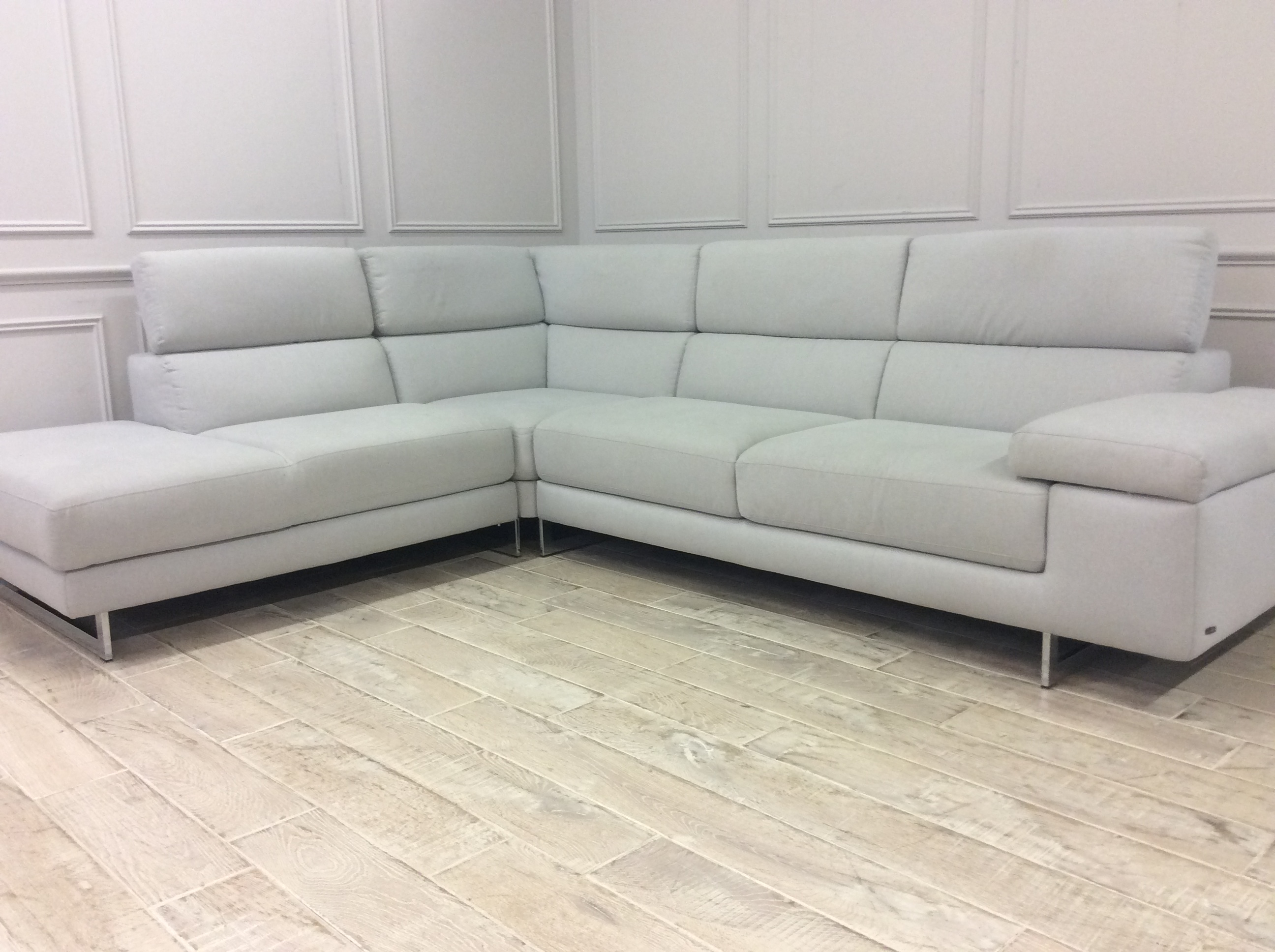 Product photograph showing Milano Corner Sofa In Italian Espero 01 Fabric With Adjustable Headrests And Chrome Legs