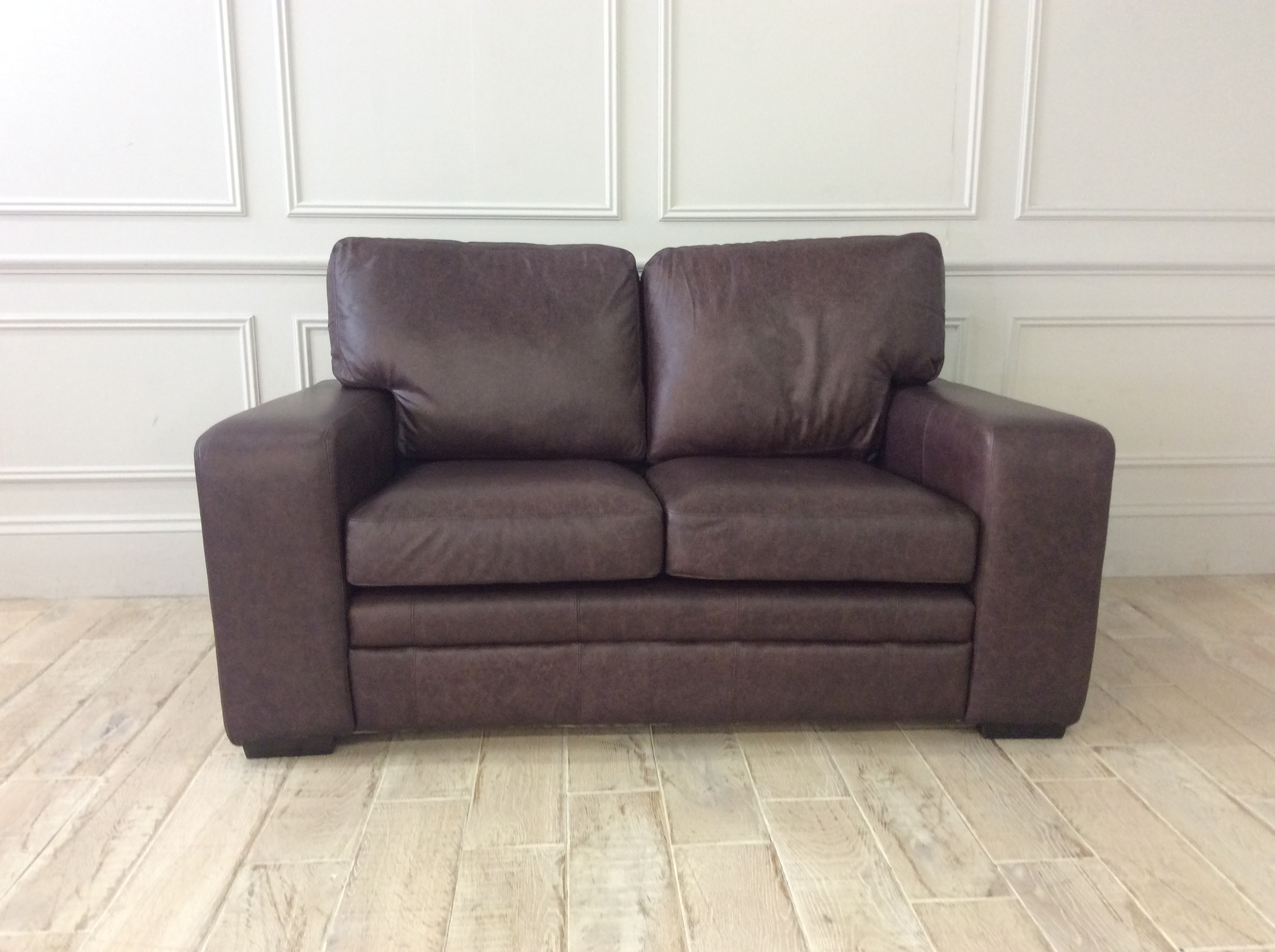 Product photograph showing Sloane 2 Seater Sofa In Dune Coffee Leather