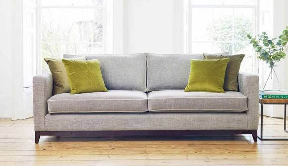 the darwin grand sofa in stain resistant broad weave linen armadillo with dark oak feet