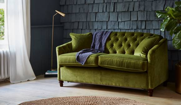 The Payton 3 Seater Sofa Bed in Stain Resistant Cotton Velvet Pine with Dark Oak Feet