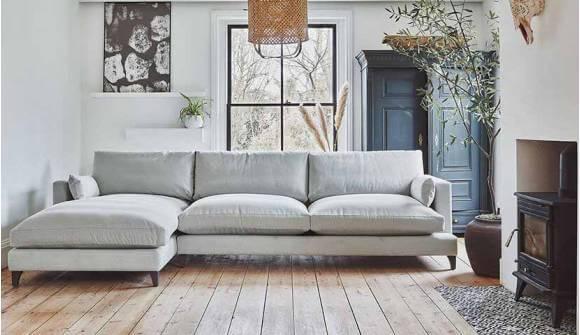 The Holland Grand Chaise Sofa in Linen Cotton Balsam with Dark oak Feet