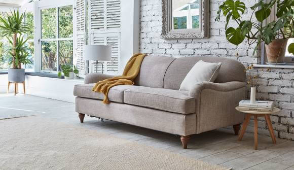 the lincoln 3 seater sofa bed in tweed boulder with medium oak feet