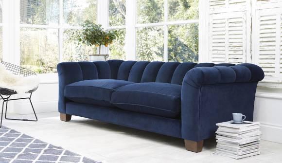 the rockingham grand sofa in easy clean plush velvet royal blue with dark oak feet