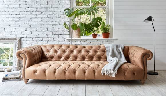 the Roslin Grand Sofa in Rustic Hennessey Leather Alpaca with light oak feet