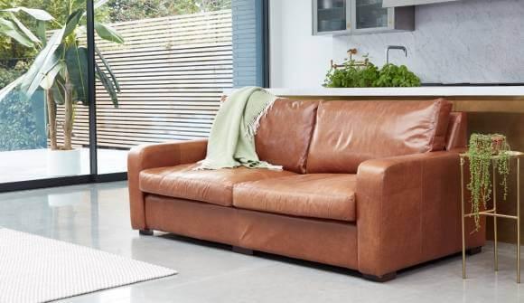 the Sandhurst 3.5 Seater sofa in Waxy Semi Aniline Tanwith medium oak feet