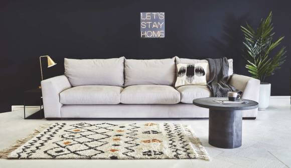 the kingston super grand sofa in linen cotton feather grey with dark oak feet
