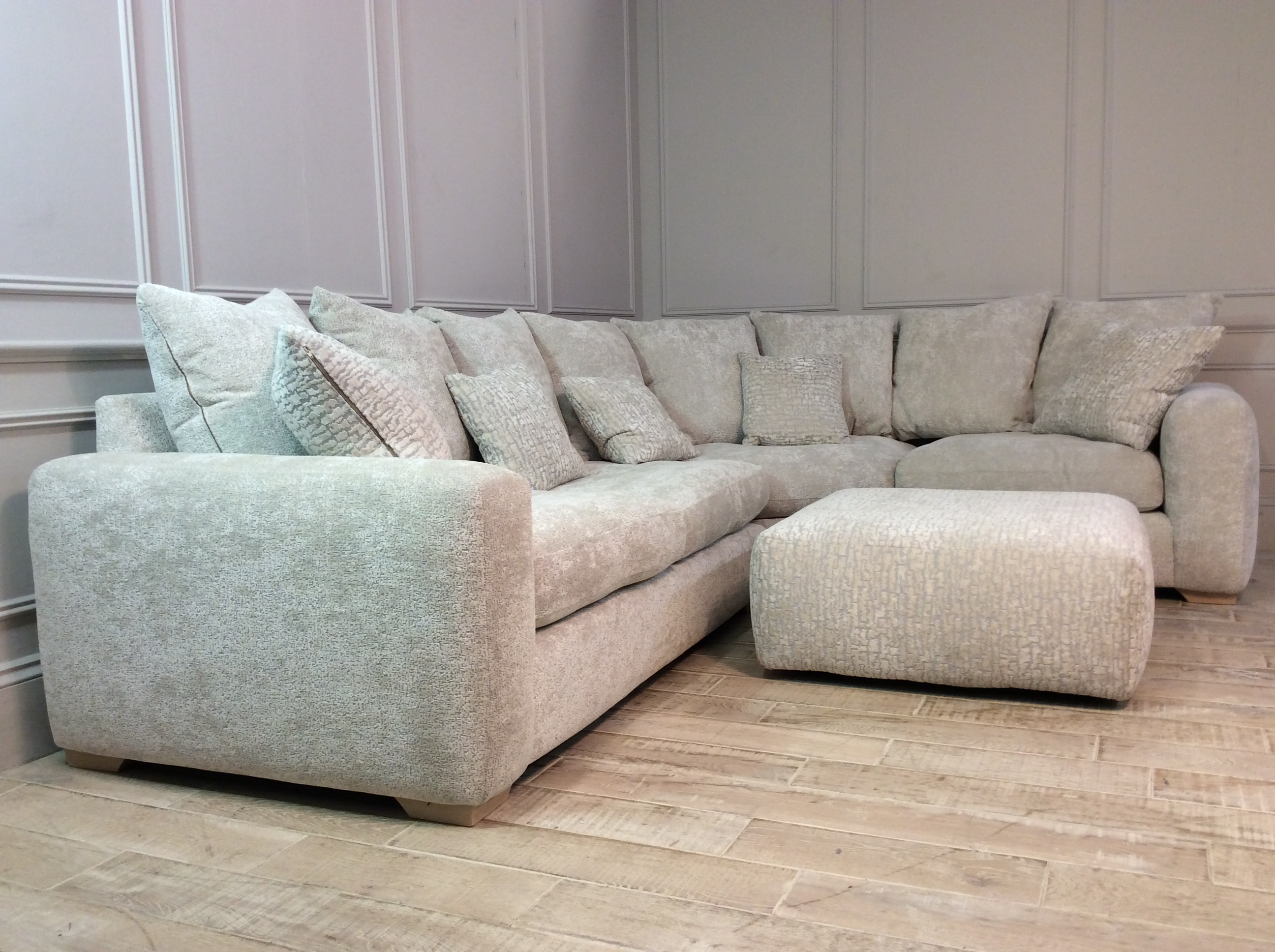 Product photograph showing Manchester Medium Corner Sofa In Oyster With Footstool