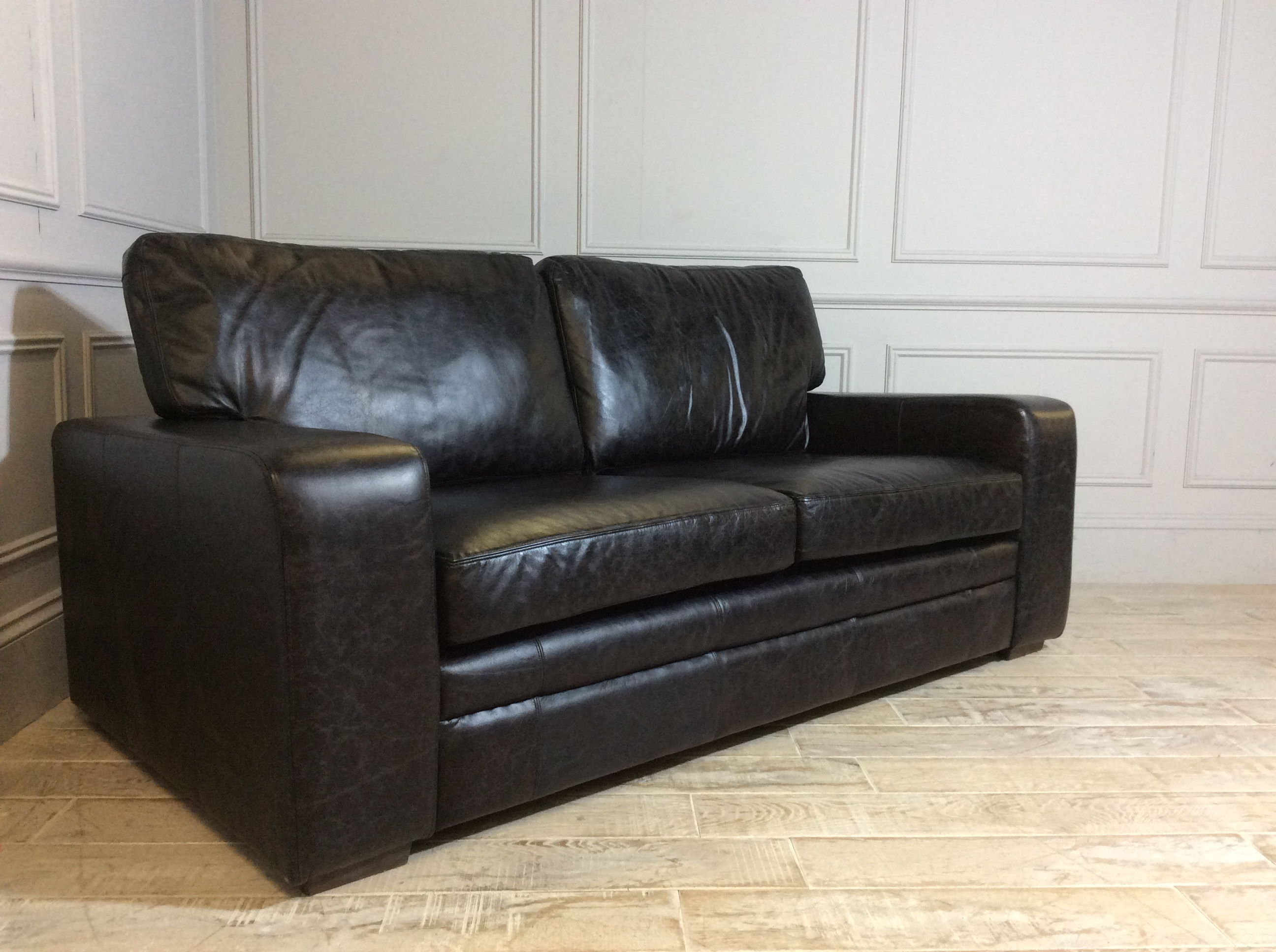 Product photograph showing Sloane 3 Seater Leather Sofa In Vintage Black