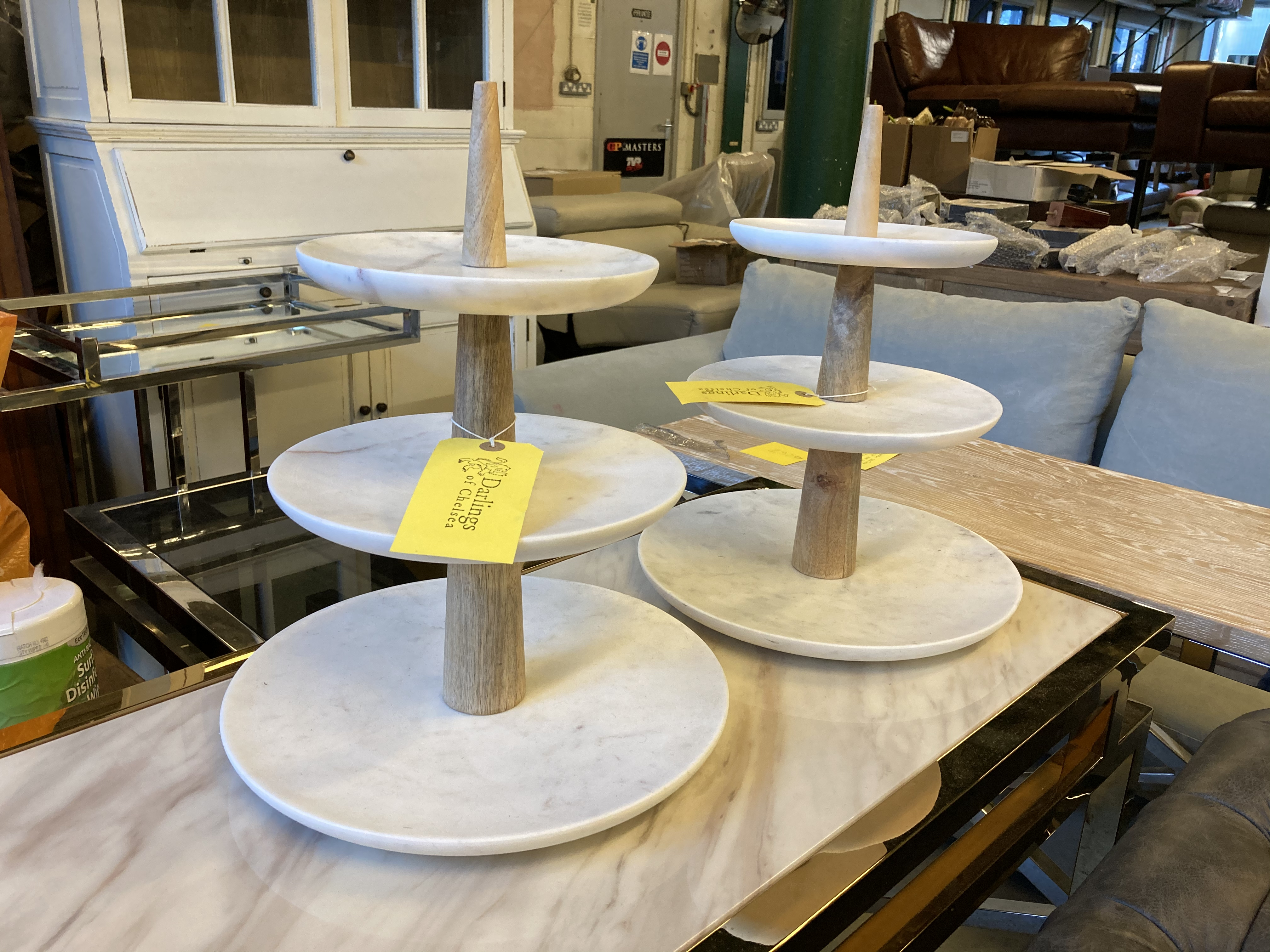 Product photograph showing Two Marble Cake Stands With Three Tiers