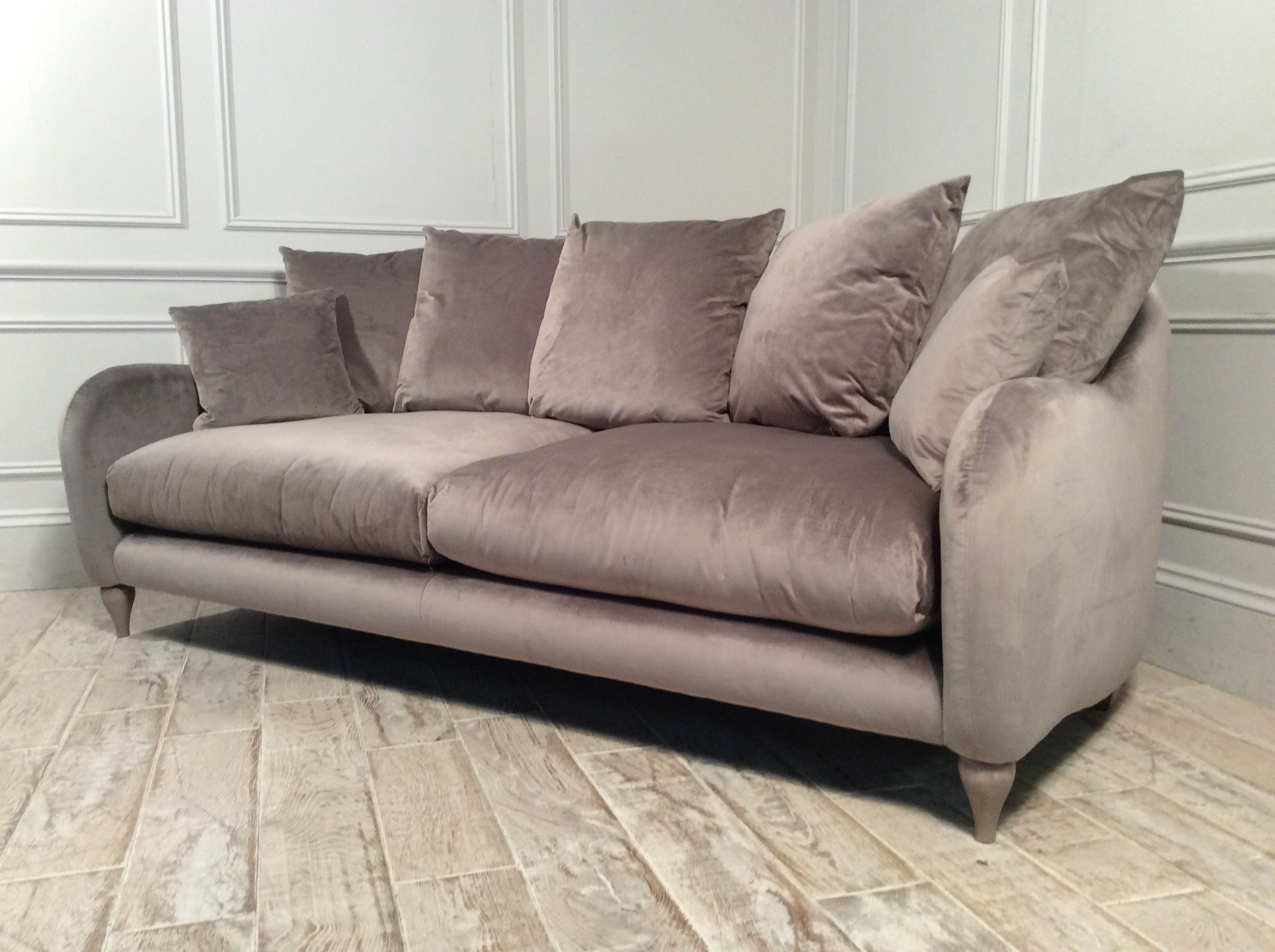 Product photograph showing Weston Scatter Back Extra Large Sofa In Lumino Velvet Mink