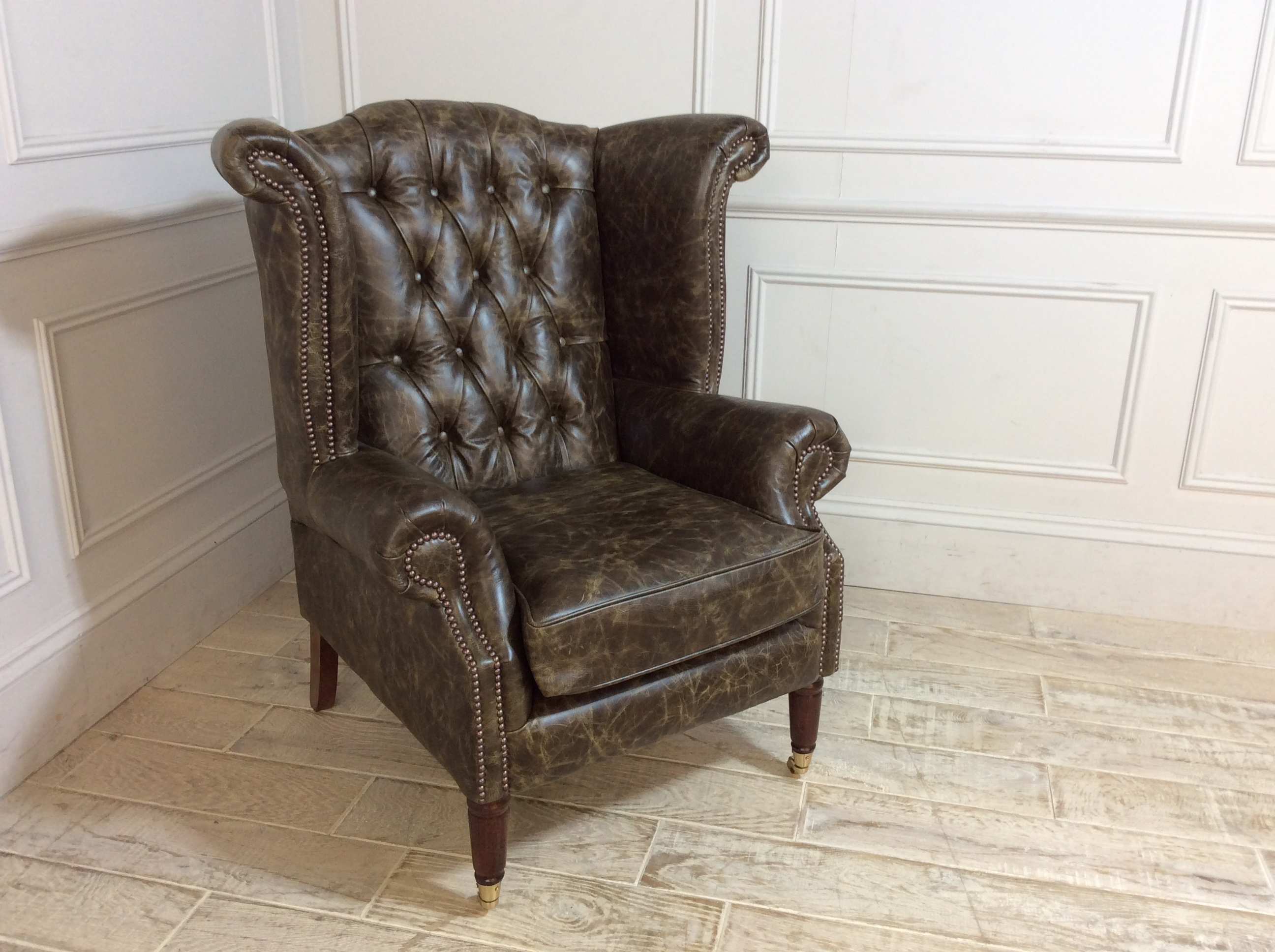Product photograph showing Queen Anne Scroll Wing Chair With Castors In Truffle