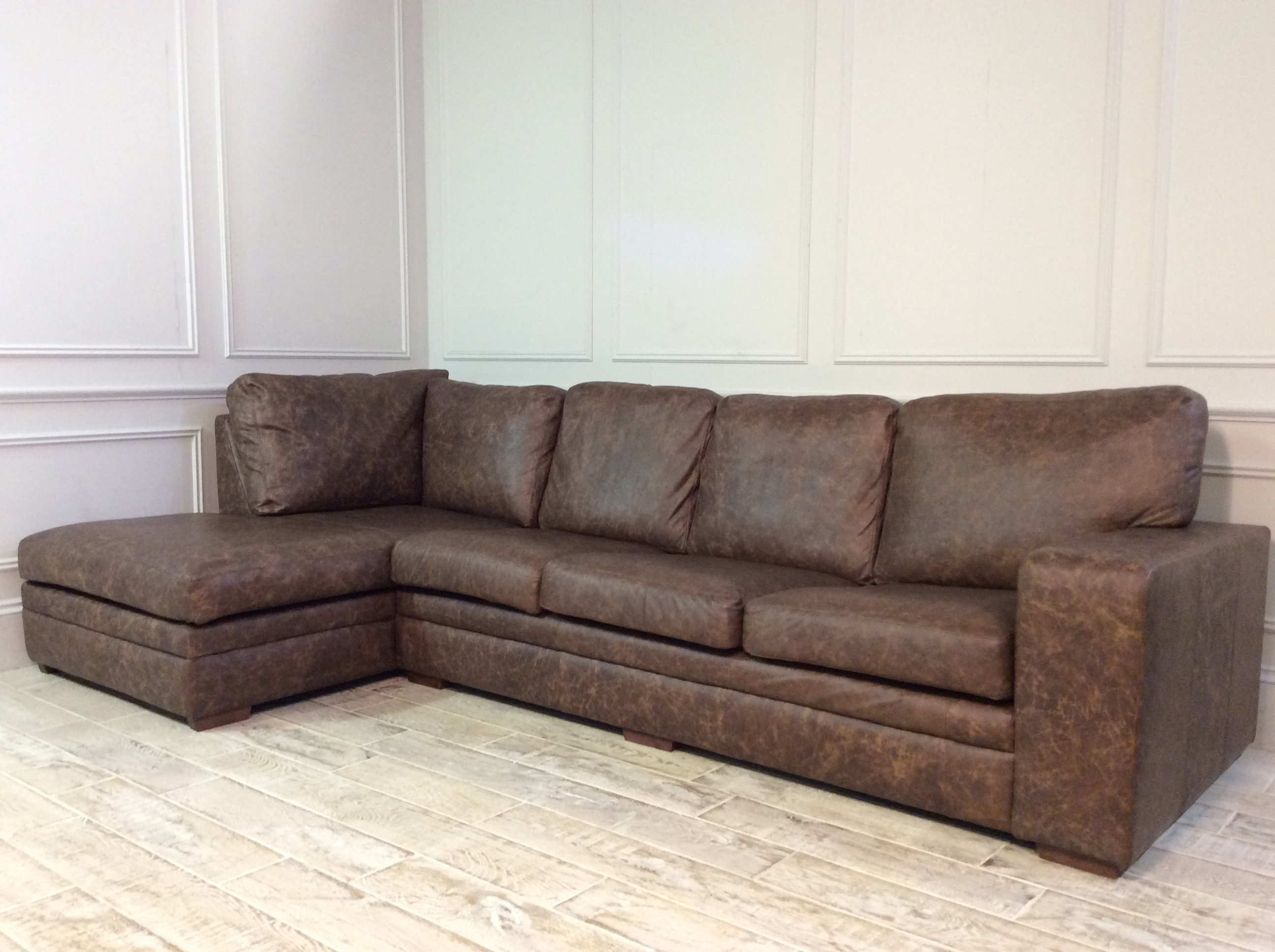 Product photograph showing Sloane 4 Seater Leather Sofa With Chaise In Rum