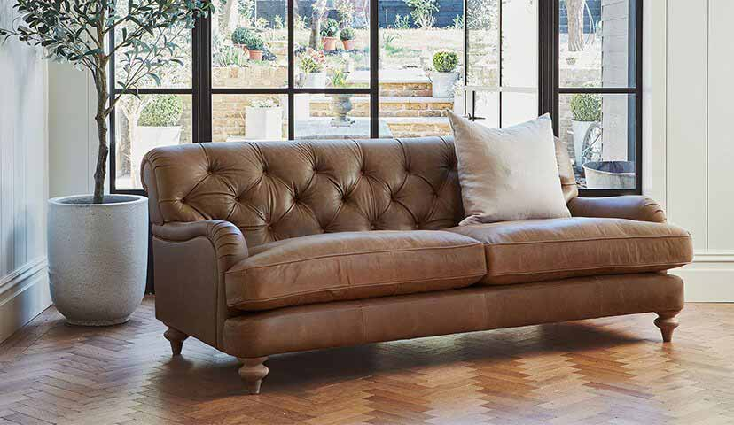 The Woodbridge large sofa in Rustic Hennessey Leather Alpaca with Light Oak Feet